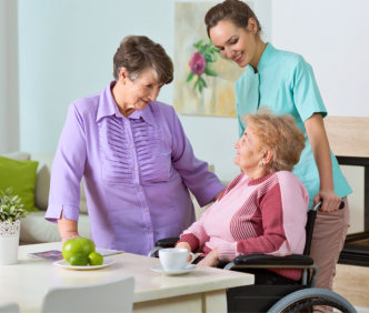 a caregiver talking with her patients