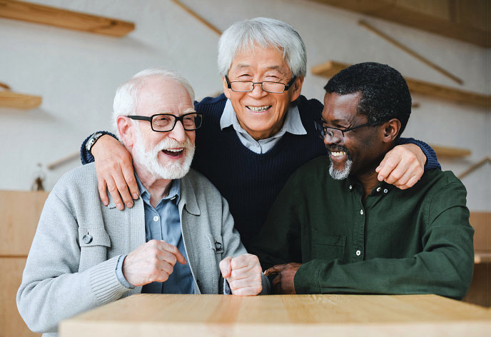 a group of senior men laughing