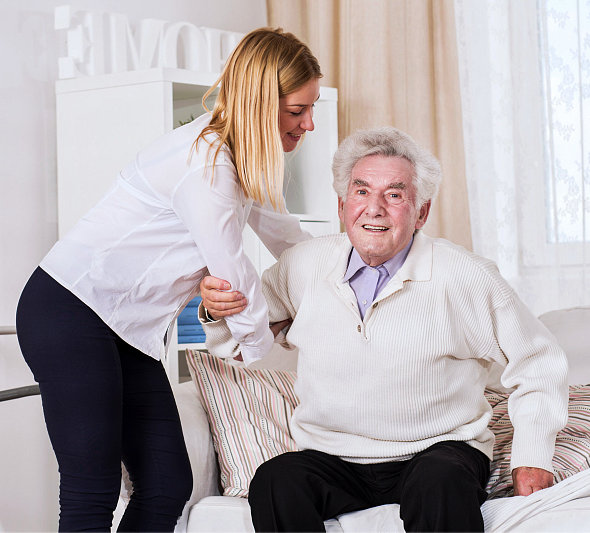 a caregiver assisting her patient sitting down