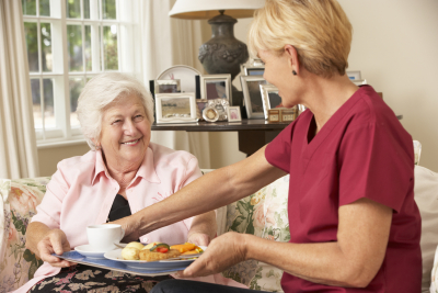 woman giving senior food